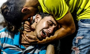 Gaza City, Palestine. Young Palestinians mourn at al-Shifa hospital morgue after two teenagers were killed in one of a series of Israeli air strikes