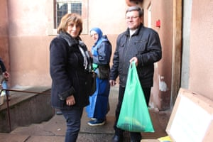 Irena and Jerzy, with sister Faustyna and their bag of festive fish
