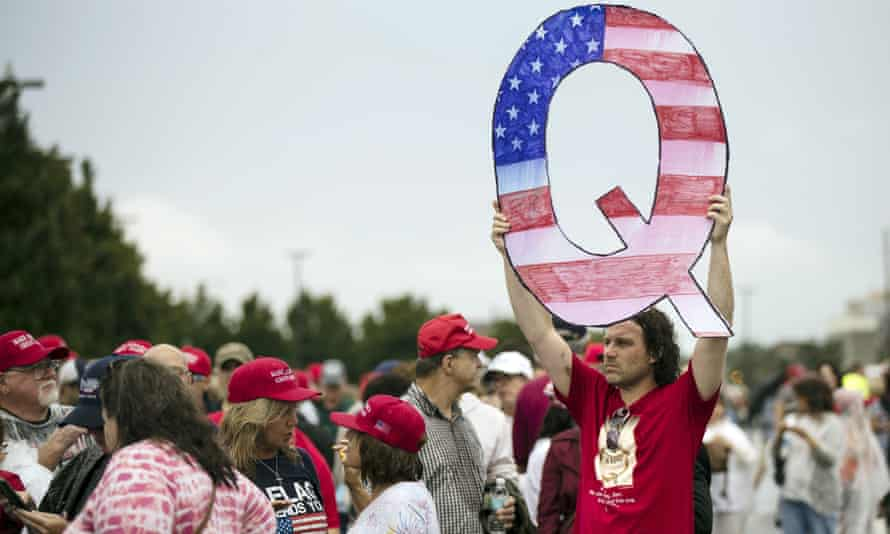 A QAnon follower outside a Donald Trump rally in Wilkes-Barre, Pennsylvania, 2 August.