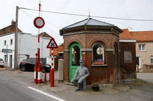 Keeping up appearances, flowers in bloom outside the old custom post in Alveringem, Belgium, at the border with France