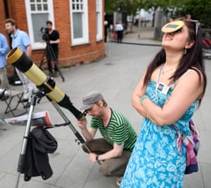 Sumitra Sri Bhashyam from Flamsteed Astronomy Society looks through protective glasses at the Royal Observatory in Greenwich, London, UK