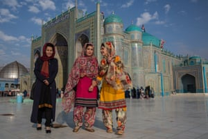 Women wearing colourful dresses at the famous Blue Mosque in Mazar-e-Sharif, where they are celebrating the new year.