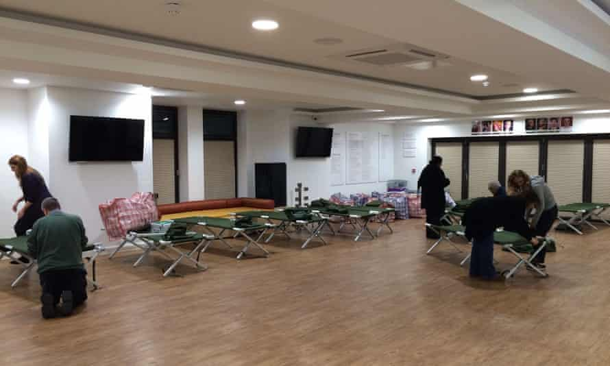 Volunteers for One Roof set up beds at the homeless shelter in Leicester.