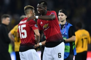 Manchester United's Paul Pogba embraces Andreas Pereira as they celebrate their victory.