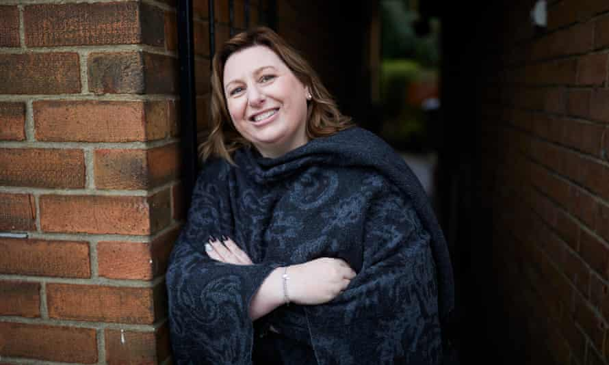 Ann McKelvey standing next to wall