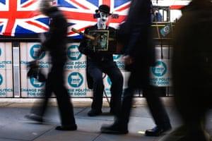 London, UKDemonstrators outside the Houses of Parliament. Prime Minister Boris Johnson published his
