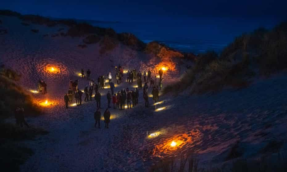 Guests on the beach for Over Lunan, Scotland.