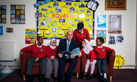 Assistant head teacher Andrew Moffat with pupils from Parkfield community school in Birmingham.