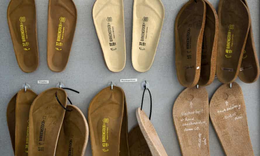 birkenstock sandal soles hang up in the factory
