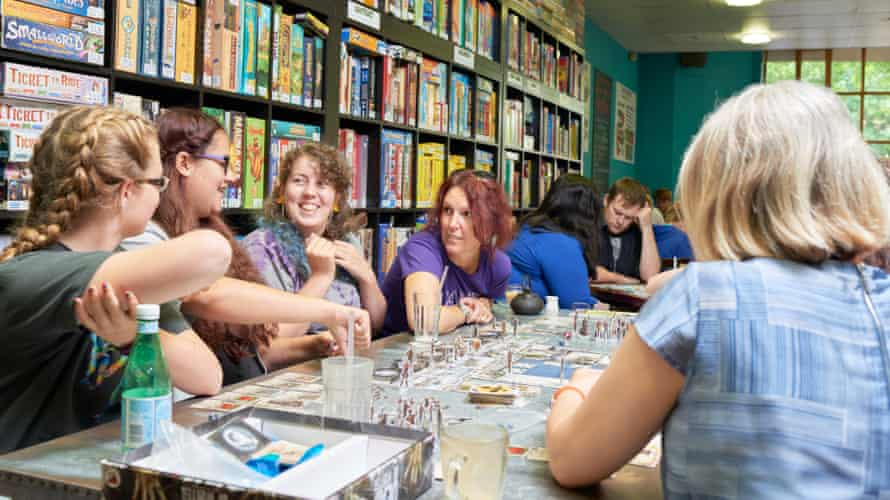 Fourteen-year-old friends Maddy Sawbridge, left, and Alex Foley, right, at Thirsty Meeples with their friends and family