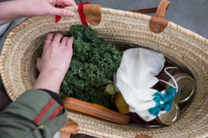 Vegetables are placed directly into a reusable shopping bag
