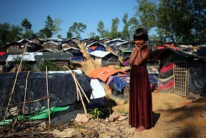 Zannat, an eight-year-old Rohingya refugee, stands at the entrance to Kutupalong refugee camp