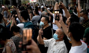 People gather to take pictures outside the US consulate in Chengdu, south-western China.