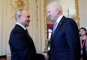Russian President Vladimir Putin (L) shakes hands with US President Joe Biden during their meeting at the 'Villa la Grange' in Geneva, Switzerland.