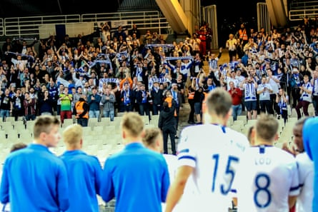 Finland fans salute the team in Athens after their final qualifying game