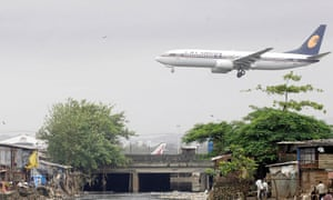 A Jet Airways plane flies into Mumbai airport