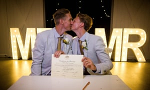 Australian Commonwealth Games sprinter Craig Burns (left) and partner Luke Sullivan at their marriage ceremony at Summergrove Estate, New South Wales.