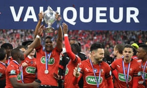 Rennes players celebrate after a raucous night in Paris.