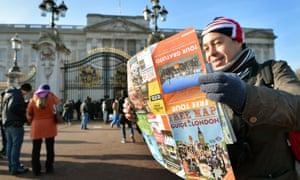 Tourists outside Buckingham Palace.