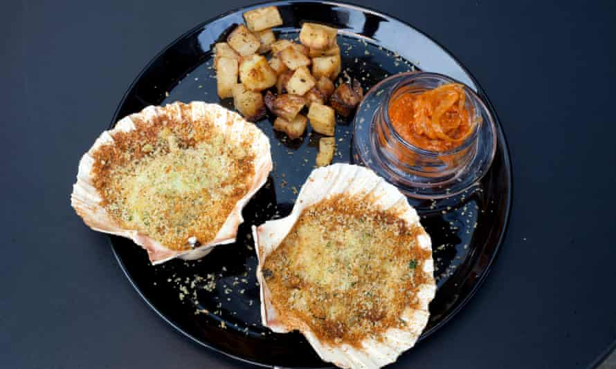 'Grilled under thick drifts of buttery golden breadcrumbs': scallops.