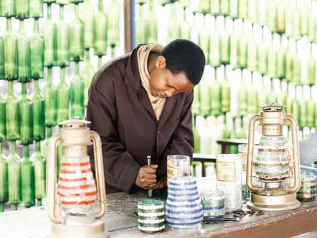 young man working on ceramics in Tanzania