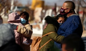 Family members respond during the funeral of a person who died of coronavirus at San Rafael Cemetery in Ciudad Juarez, Mexico, on December 2, 2020.