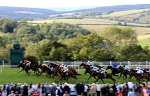 Dirty Rascal ridden by Jockey Tom Marquand (far left side by rails, partially hidden) wins the New and Lingwood Handicap