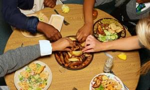 Children prepare food at Kids Company.