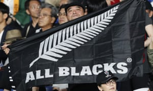 A New Zealand fan holds an All Blacks flag and cheers for his team ahead of the start of a Rugby World Cup game between New Zealand and South Africa in Yokohama, Japan. (AP Photo/Shuji Kajiyama, File)
