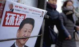 A news stand stocking a magazine with Xi Jinping and Donald Trump on the front cover
