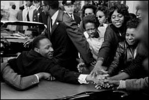 Baltimore. MD. October 31, 1964. Dr. Martin Luther KING, Jr. being greeted on his return to the US after receiving the Nobel Peace Prize.This extraordinary collection of images – including Martin Luther King, Jr. greeting an eager crowd in an open-topped car, incarcerated black men in the Deep South and families living defiantly ordinary lives – conveys with power and dignity the exhausting, endless struggle of being black in white America.read more https://www.theguardian.com/artanddesign/2020/oct/11/the-big-picture-a-hands-on-martin-luther-king