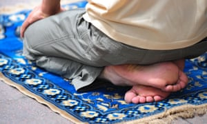 A Uighur Muslim prays on his prayer matt during Friday prayers in Urumqi in China's Xinjiang province.