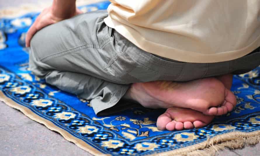 A Uighur Muslim prays on his prayer matt during Friday prayers in Urumqi in China's Xinjiang province.
