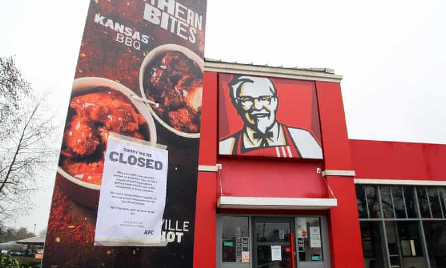 A closed sign outside a KFC restaurant in Ashford, Kent.