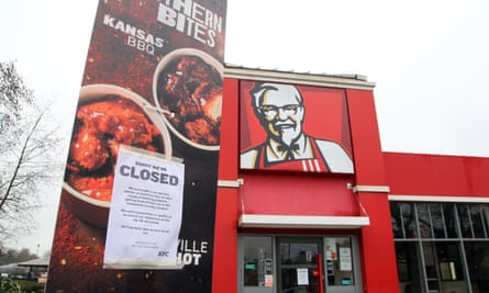 A closed sign outside a KFC restaurant in Ashford, Kent.
