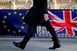 London, England A pedestrian passes the flags of anti-Brexit protesters