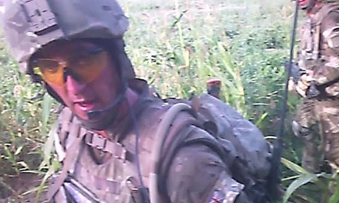 Buildup to moment marine shoots dead wounded Taliban fighter – video