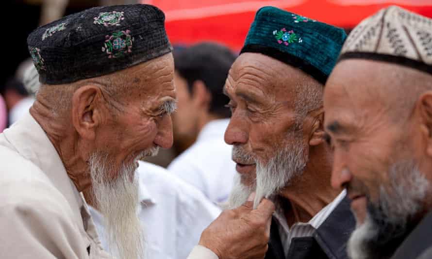 Uighur men in conversation in Xinjiang