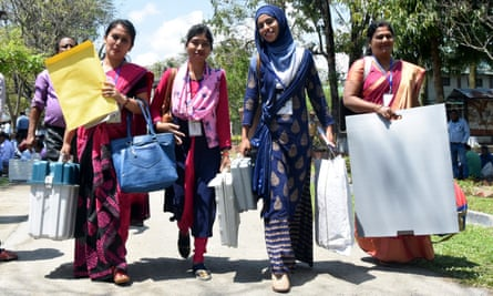 Indian polling officials leave for their booths in the state of Assam.
