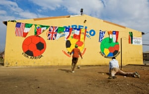 Boys playing ball in Sharpeville as South Africa gears up to host the FIFA 2010 world cup tournament in South Africa.