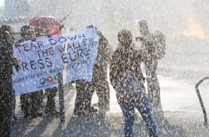 Activists hold up a banner