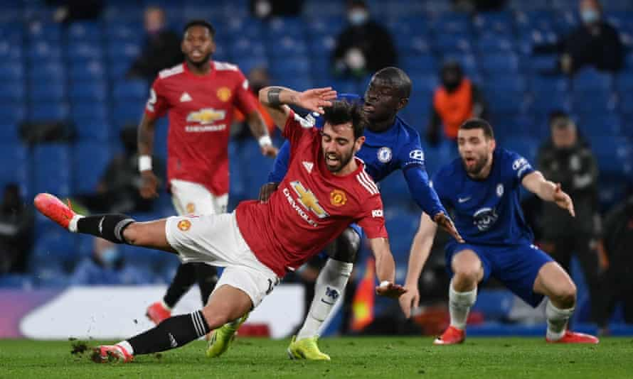 Manchester United's Bruno Fernandes collides with N'Golo Kante during the draw against Chelsea.