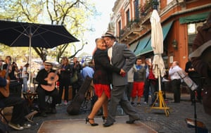 Dancers perform a street tango at Plaza Dorrego in San Telmo, Buenos Aires, Argentina