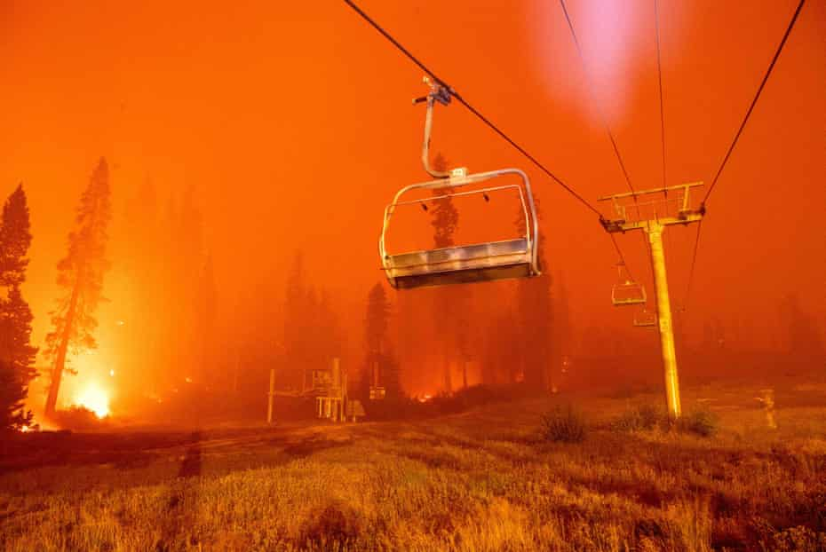 Flames from the Caldor fire surround a chairlift at the Sierra-at-Tahoe ski resort on August 29.