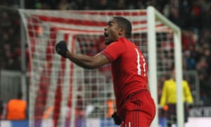 Douglas Costa of Bayern Munich celebrates his side's first goal during the Champions League match against Olympiakos.