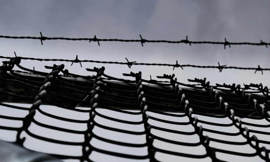 High security fence and sky