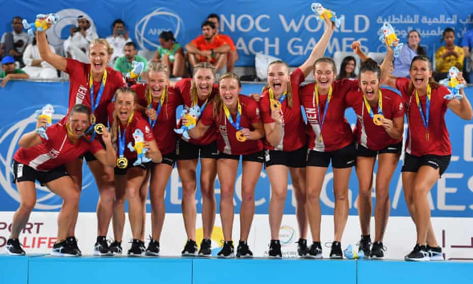 The Danish women's beach handball team celebrate after winning gold at the 1st ANOC World Beach Games in Doha in 2019.