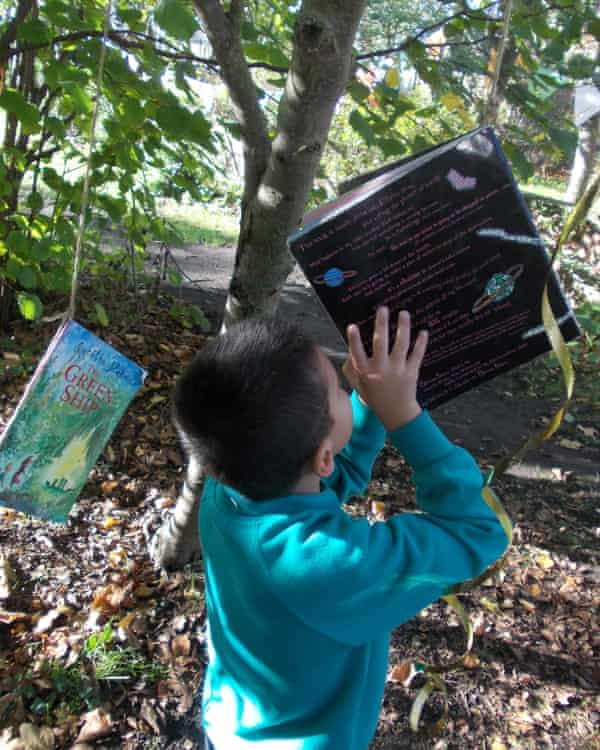 Pupil reading a book in the forest