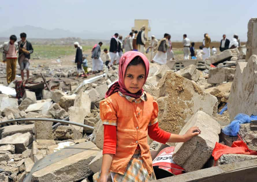 A young Yemeni poses in front of the ruins of her family house a day after it was destroyed by an air strike carried out by the Saudi-led coalition in Sana'a.