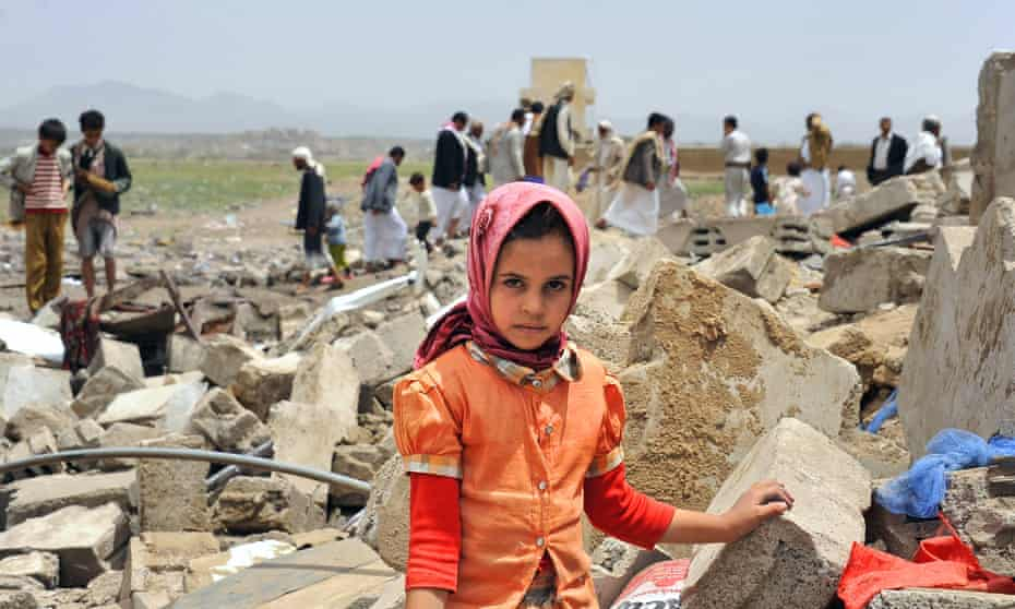 A Yemeni girl in the ruins of a house destroyed by Saudi-led airstrikes in Sanaa, June 2015